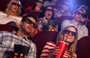 bigstock-Young-people-sitting-at-cinema-54560258